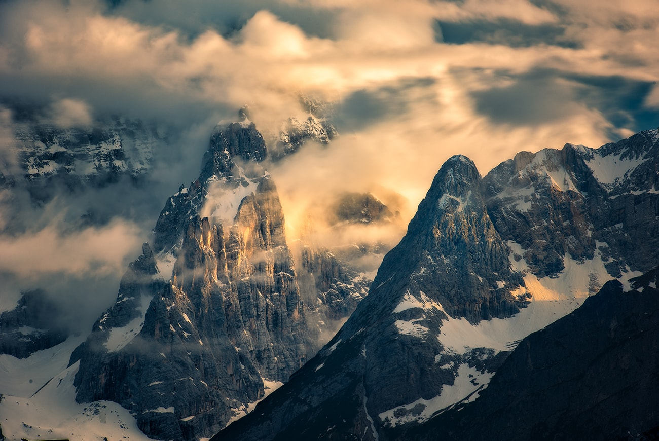 The dolomites mountains is covered by the clouds