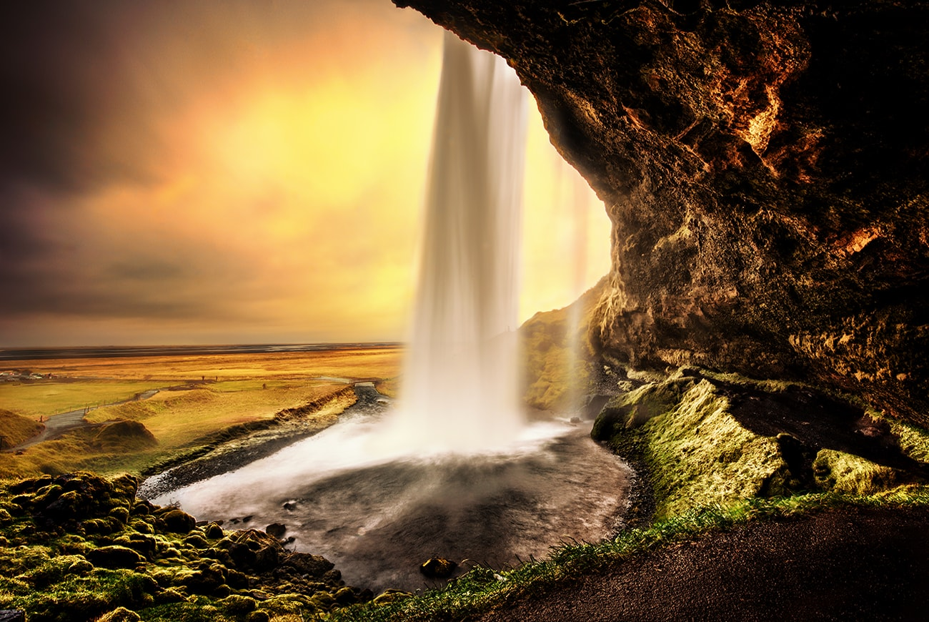 Seljalandsfoss is a waterfall that can be fully encircled, situated on the South Coast of Iceland with a drop of 60 metres (200 feet).